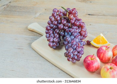 sweet fruit on old wooden table.