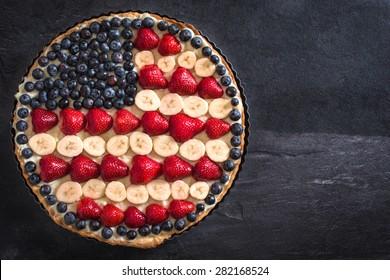 Sweet fruit and vanilla cream pie with American flag design,selective focus and blank space
