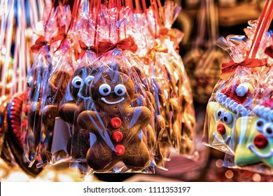 Sweet Gingerbread on Night Christmas Market at Gendarmenmarkt in Winter Berlin, Germany. Advent Fair Decoration and Stalls with Crafts Items on the Bazaar.