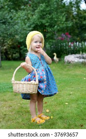 Sweet girl and basket with apples