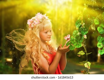 Sweet girl with butterfly wings in the fairy forest.
