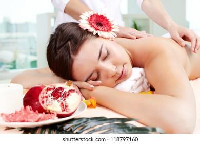 Sweet girl enjoying gentle massaging