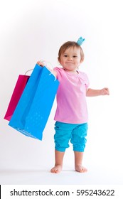 Sweet girl in pink and blue design with paper bags isolated on white background.