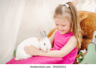 Sweet girl with a white Easter bunny