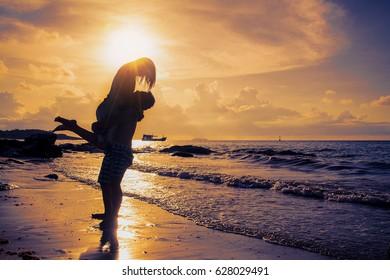 Sweet girlfriend on the beach at evening.