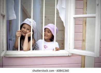 Sweet girlfriends on the window