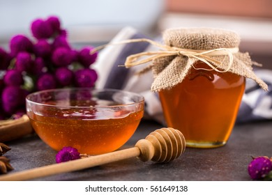 sweet golden honey in glass jar on table