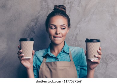 Sweet, gorgeous, nice, dream, dreamy girl make the best latte and cappuccino beverage looks aside and stand isolated on gray textured wall background do not know what to choose
