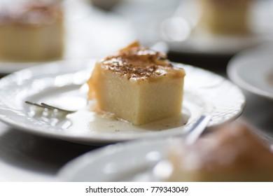 sweet greek dessert - semolina cake with honey and cinnamon