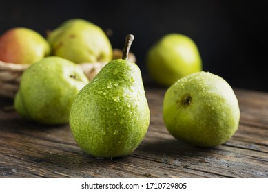 Sweet green pears on the wooben rustic table, selective focus image