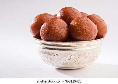 Sweet Gulab Jamun -popular Indian dessert or Doughnuts for festivals and weddings