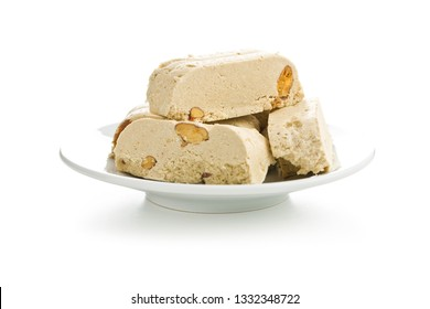 Sweet halva dessert slices with almonds isolated on white background..