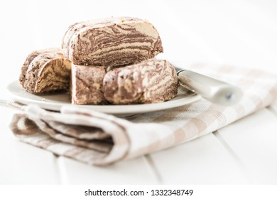 Sweet halva dessert slices with cocoa on plate.