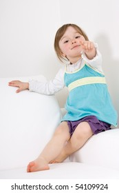 sweet happy little girl on sofa