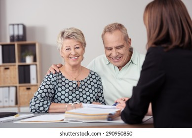 Sweet Happy Matured Couple Meeting with their Female Financial Agent for Their New Investment at the Office.