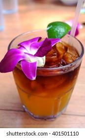 Sweet Hawaiian Mai Tai cocktail with an orchid flower