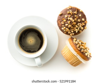 Sweet hazelnut muffins and coffee cup isolated on white background.