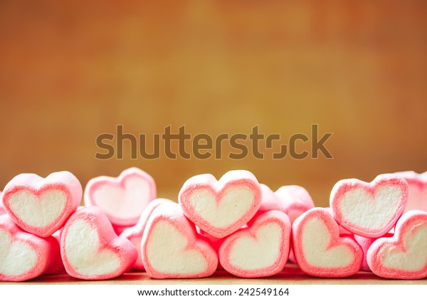sweet heart shape of marshmallows with note book on wooden background,decoration for love and valentine day concept.