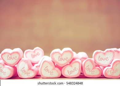 sweet heart shape of marshmallows on wooden background,decoration for love and valentine day concept.