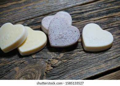 Sweet hearts made of white chocolate on a wooden background.selective focus