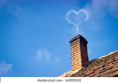 Sweet home with full of love. Heart shaped smoke coming from the chimney.