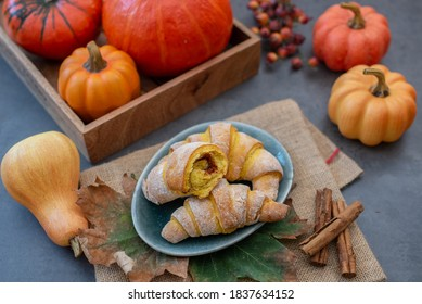 Sweet home made pumpkin crescent rolls on a table