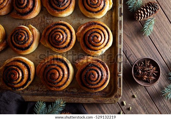 Sweet Homemade christmas baking. Cinnamon rolls buns with cocoa filling. Kanelbulle swedish dessert. Cinnabon roll bread, homemade bakery.