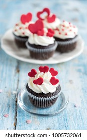 Sweet homemade cupcakes with hearts on the top,valentines day concept and selrctive focus