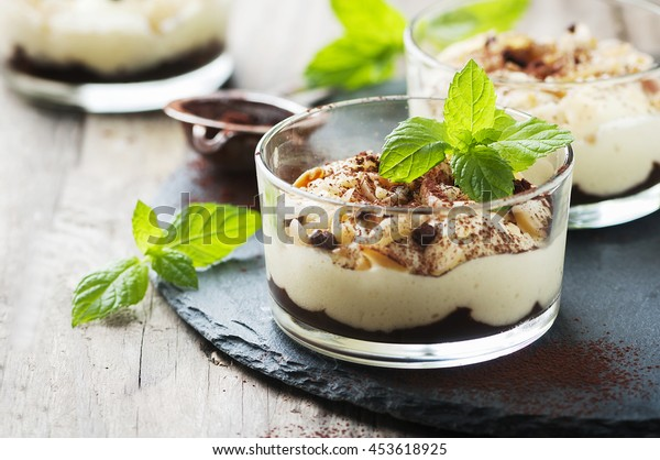 Sweet homemade dessert with cream and chocolate, selective focus
