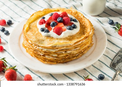 Sweet Homemade Layed Crepe Cake with Berries and Whippe Cream