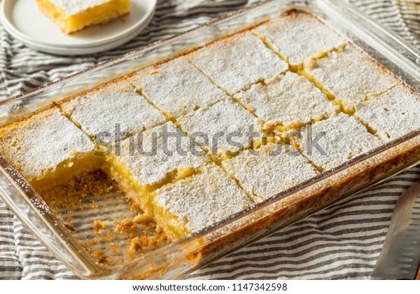 Sweet Homemade Lemon Bars with Powdered Sugar for Dessert