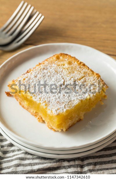 Sweet Homemade Lemon Bars with Powdered Sugar for Dessert