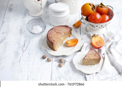 sweet homemade pastries with persimmons, on white tableware and white background