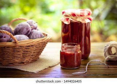 Sweet homemade plum jam and fresh autumn fruits