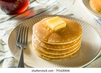 Sweet Homemade Stack of Pancakes with Butter and Syrup for Breakfast