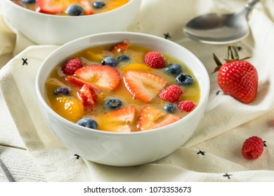 Sweet Homemade Strawberry Fruit Soup with Blueberries and Oranges