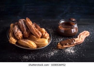 Sweet homemame churros with chocolate,selective focus