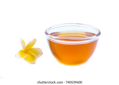 sweet honey in a clear cup isolated on white background