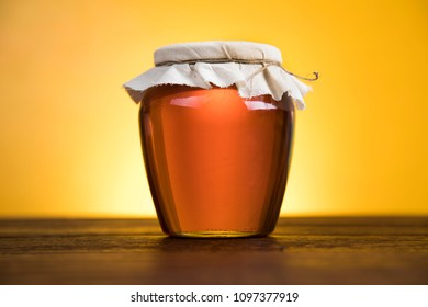 Sweet honey in the comb, glass jar