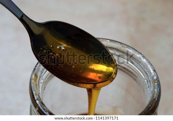 Sweet honey on the tea spoon