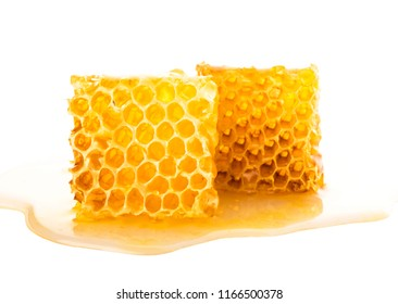 Sweet honeycomb isolated on white, bee products by organic natural ingredients concept