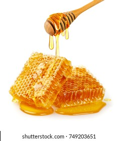 Sweet honeycomb and wooden dipper with dripping honey isolated on white background with copy space, bee products by organic natural ingredients concept