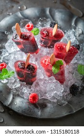 Sweet ice cream with berries on a stick