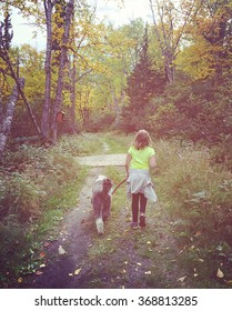 sweet instagram of young girl walking her dog on a forest path