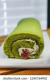 Sweet Japanese Matcha Green Tea Swiss Cake Roll with Azuki Bean Swirl for Dessert
