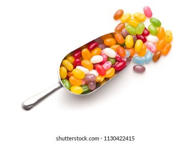 Sweet jelly beans in scoop isolated on white background.