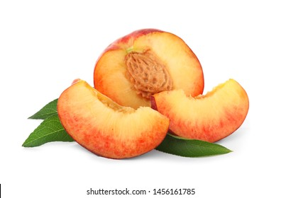 Sweet juicy cut peaches with leaves on white background