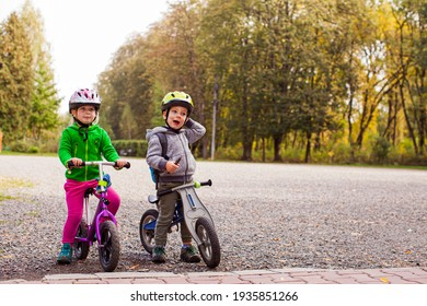 Sweet kids on balance bikes outdoors at the park