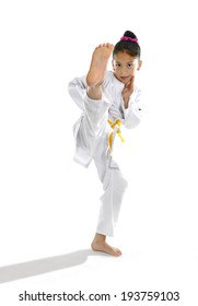 sweet latin little girl stretching leg in martial arts practice training kick and attack in plastic action like karate kid  isolated on white background