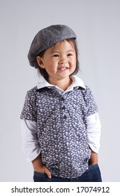 sweet little asian girl with a hat